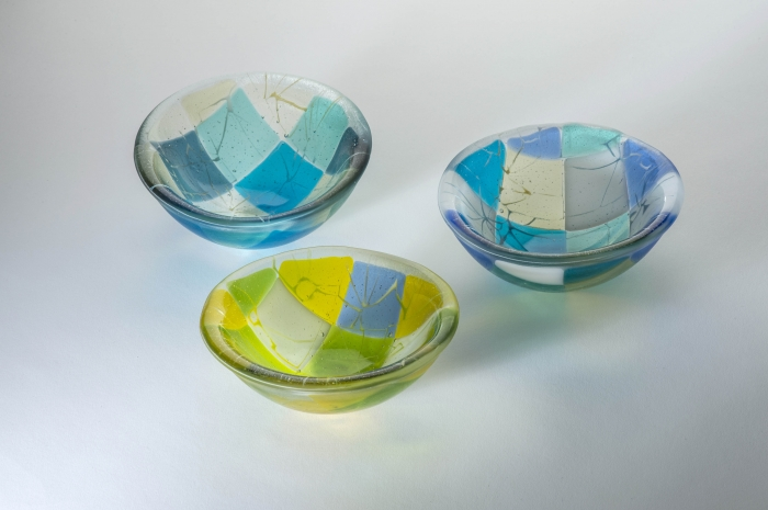 Group of 15cm diameter kilnformed glass bowls in Spring and Summer colourways.