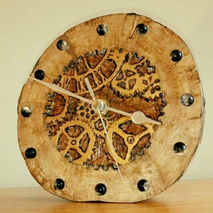 Reclaimed timber clock engraved with a cog design and painted with acrylic paints.